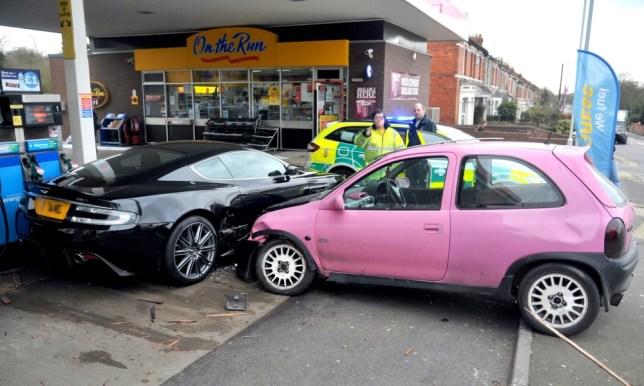 Aston Martin written off by pink Vauxhall Corsa