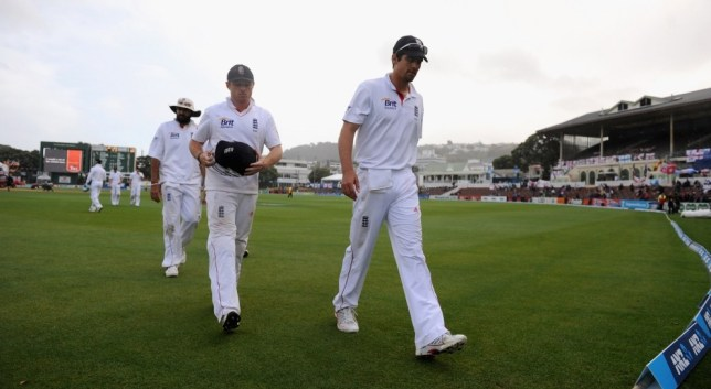 WELLINGTON, NEW ZEALAND - MARCH 17:  England captain Alastair Cook and Ian Bell leave the field as rain stops play during day four of the second Test match between New Zealand and England at Basin Reserve on March 17, 2013 in Wellington, New Zealand.  (Photo by Gareth Copley/Getty Images)