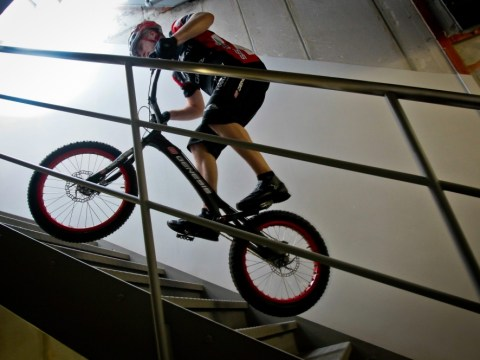 Take the lift? No, this way is truly bespoke: Extreme cyclist bounces to top of skyscraper