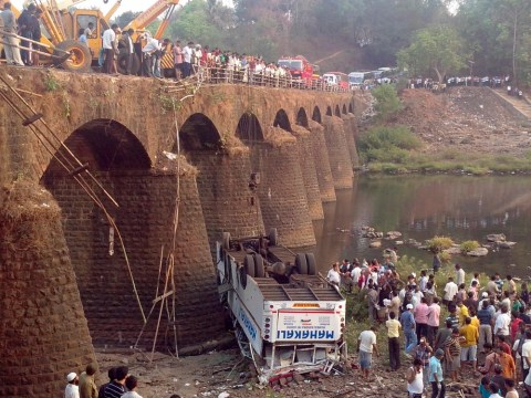 At least 37 people killed after bus plunges off bridge in India