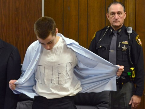 High school spree shooter wears 'killer' T-shirt to court as he mocks families of his victims