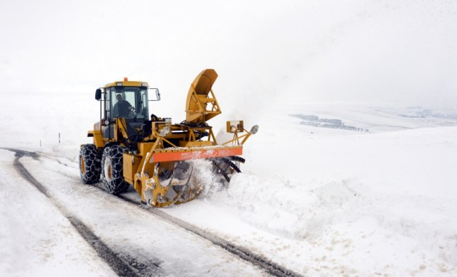 A snow blower clears the road on the way to Allenheads in Northumberland after more heavy snow hit the region. PRESS ASSOCIATION Photo. Picture date: Wednesday March 20, 2013. See PA story WEATHER Cold. Photo credit should read: Owen Humphreys/PA Wire