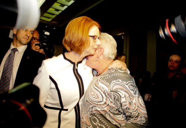 Australian Prime Minister Julia Gillard (L)  receives a hug from a guest at the national apology for forced adoptions at Parliament House in Canberra+ receives a hug from a guest at the national apology for forced adoptions at Parliament House in Canberra, Australia, 21 March 2013. A Senate inquiry found as many as 250,000 babies were forcibly taken from their mothers.  EPA/Lukas Coch AUSTRALIA AND NEW ZEALAND OUT
