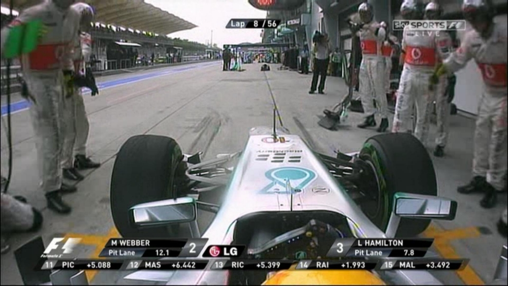 Lewis Hamilton mistakenly drives into his old McLaren pit lane during Malaysian Grand Prix