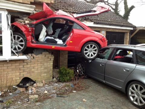 Driver seriously hurt after Audi TT launches off road and ends up embedded through window of house