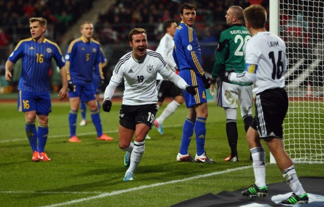 NUREMBERG, GERMANY - MARCH 26: Mario Goetze (C) of Germany celebrates his team's second goal with team mate Philipp Lahm during the FIFA 2014 World Cup qualifier between Germany and Kazakhstan at Grundig-Stadion on March 26, 2013 in Nuremberg, Germany.  (Photo by Alex Grimm/Bongarts/Getty Images)