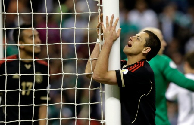 Mexico's Javier Hernandez reacts after missing a chance to score during a 2014 World Cup qualifying soccer game against the United States at the Aztec stadium in Mexico City, Tuesday, March 26, 2013. The game ended 0-0. (AP Photo/Eduardo Verdugo)