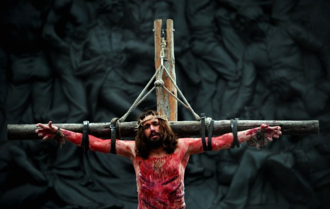 An actor playing Jesus hangs on a cross during a performance of the Passion of Jesus by the Wintershall Players in Trafalgar Square, central London on March 29, 2013.  AFP PHOTO / CARL COURTCARL COURT/AFP/Getty Images