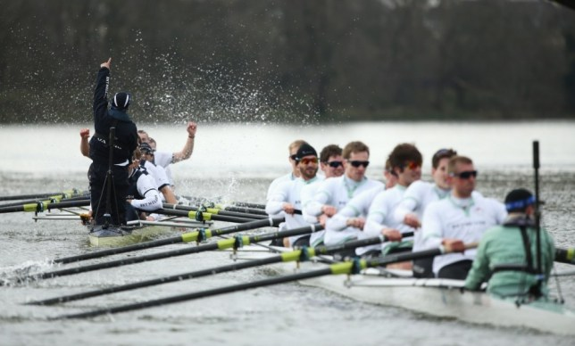 LONDON, ENGLAND - MARCH 31:  The Oxford crew celebrate victory after the BNY Mellon 159th Oxford versus Cambridge University Boat Race on The River Thames on March 31, 2013 in London, England.  (Photo by Richard Heathcote/Getty Images)