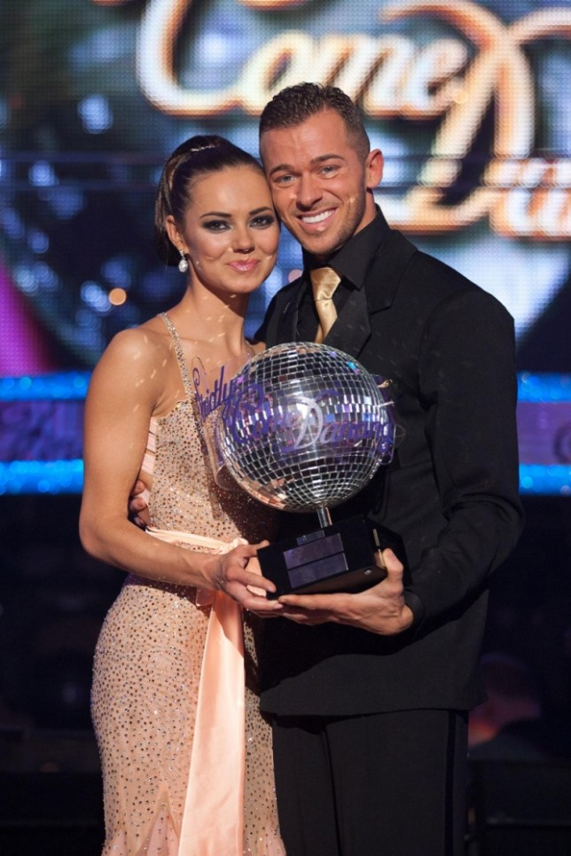Kara Tointon and Artem Chigvintsev raise the Strictly trophy (Picture: PA)
