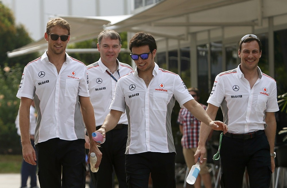 McLaren's Jenson Button and Sergio Perez clash in Bahrain Grand Prix