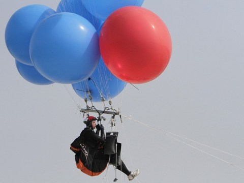 Daredevil floats across South African waters with helium balloons