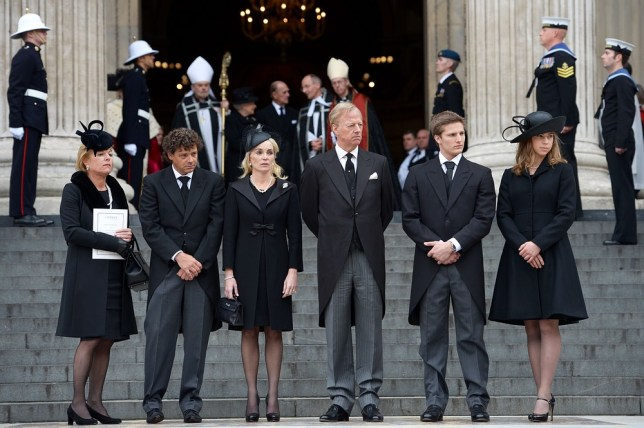 Carol Thatcher, Marco Grass, Sarah Thatcher, Mark Thatcher, Michael Thatcher and Amanda Thatcher look on from the steps of St Paul's Cathedral as the coffin is placed in the hearse after the ceremonial funeral of Lady Baroness Thatcher at St Paul's Cathedral in London. (Picture: Jeff J Mitchell/Getty Images)