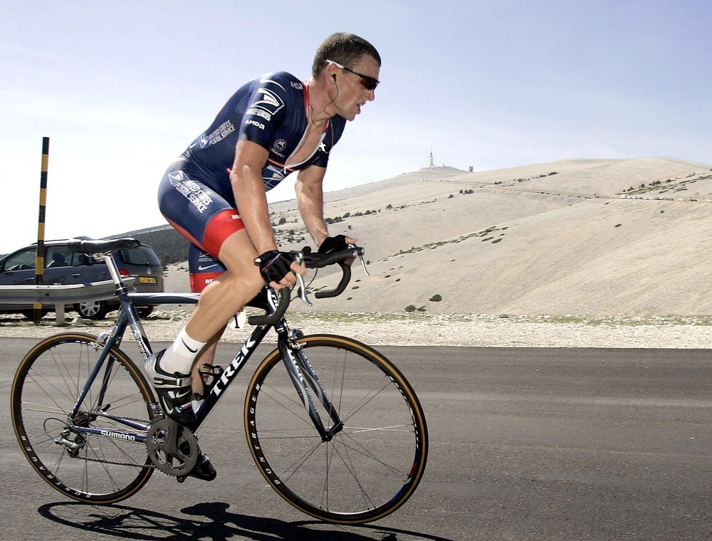 Lance Armstrong pulls out of swimming event after objections from governing body