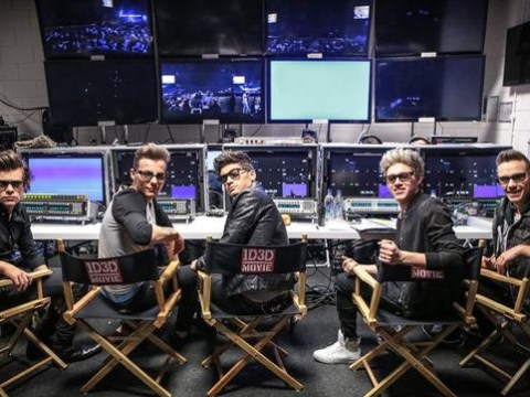 One Direction pose in directors' chairs in new 3D movie image
