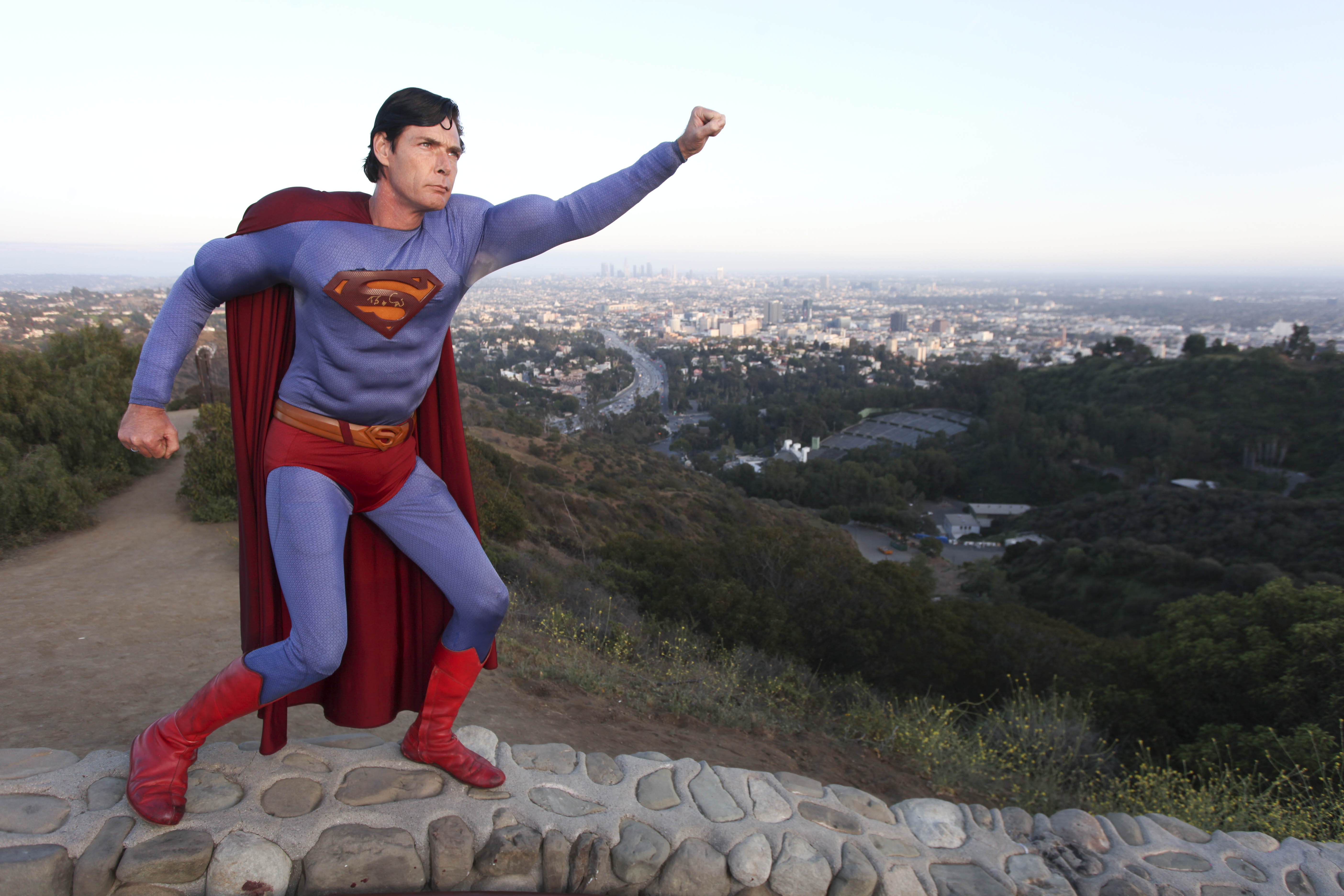Caped collector: Superman obsessive's 15,000 toys, models and statue made wife take flight