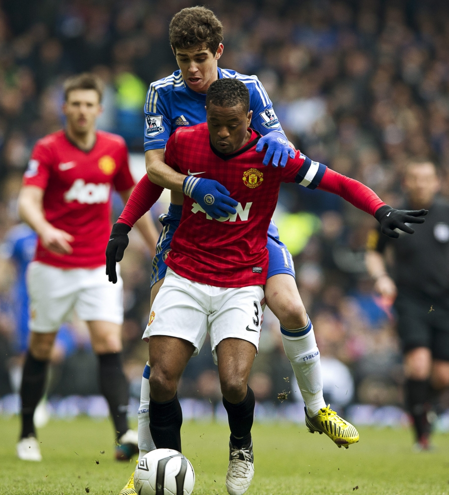 epa03646734 Oscar (rear) of Chelsea vies for the ball with Patrice Evra (front) of Manchester United during their English FA Cup quarter final replay soccer match Chelsea against Manchester United at Stamford Bridge in London, Britain, 01 April 2013.  EPA/KERIM OKTEN DataCo terms and conditions apply. https://www.epa.eu/downloads/DataCo-TCs.pdf