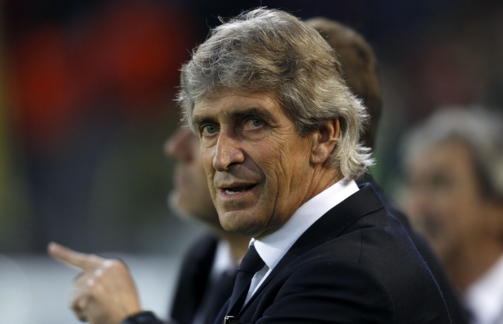 Malaga's coach Manuel Pellegrini is pictured before the Champions League quarter-final second leg soccer match against Borussia Dortmund, in the western German city of Dortmund April 9, 2013.      REUTERS/Ina Fassbender (GERMANY  - Tags: SPORT SOCCER)