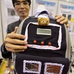 epa03656619 Exhibitors display their inventions at the 41st International Exhibition of Inventions, New Techniques and Products, in Geneva, Switzerland, 10 April 2013. Here, Chen Hsing-Feng of Taipei presents his invention, a weight-alert backpack which warns students if the load is too heavy. Also with a luminous alert to protect them at night. Charging devices for mobile devices are included. 700 exhibitors from around the world are presenting around 1,000 products hoping to catch the eye at the fair which runs from 10 to 14 April.  EPA/MARTIAL TREZZINI
