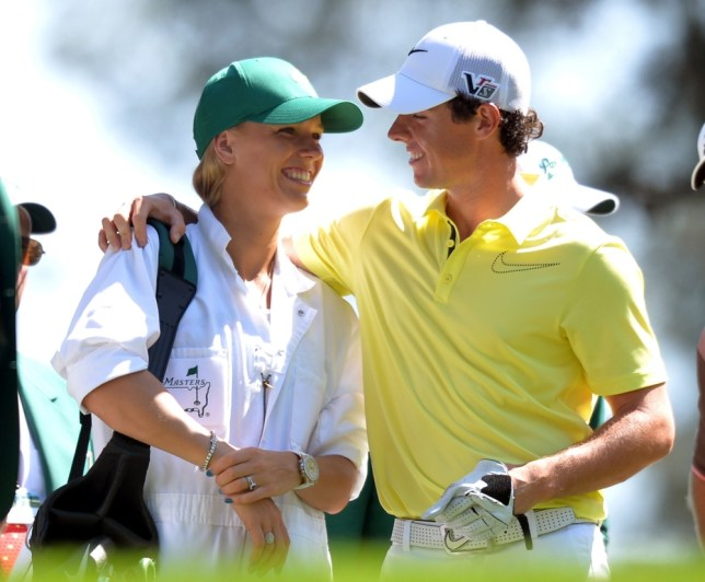 Rory McIlroy of Northern Ireland and his girlfriend tennis star Caroline Wozniacki speak as they play in the Par 3 Contest at the 77th Masters golf tournament at Augusta National Golf Club on April 10, 2013 in Augusta, Georgia. Tournament competition begins April 11.    AFP PHOTO / JIM WATSON        (Photo credit should read JIM WATSON/AFP/Getty Images)