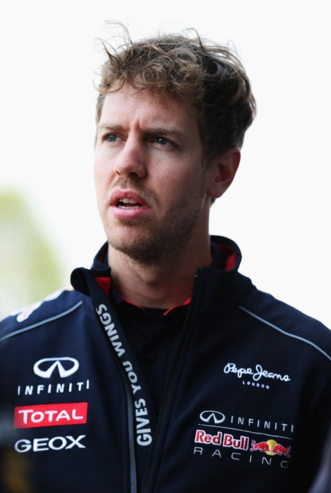 SHANGHAI, CHINA - APRIL 11:  Sebastian Vettel of Germany and Infiniti Red Bull Racing walks in the paddock during previews to the Chinese Formula One Grand Prix at the Shanghai International Circuit on April 11, 2013 in Shanghai, China.  (Photo by Mark Thompson/Getty Images)