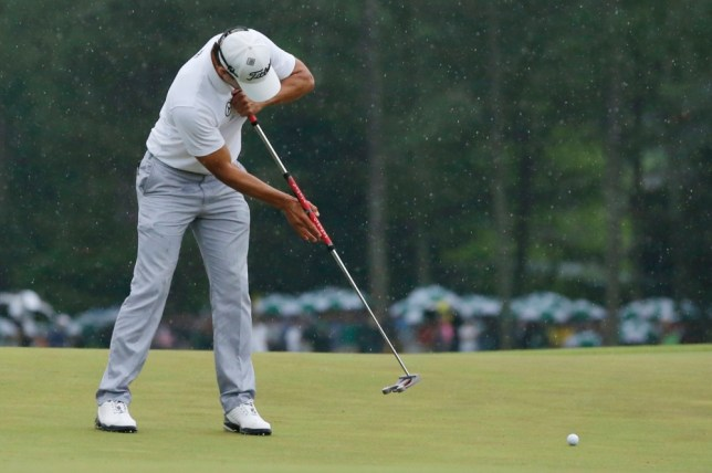 Adam Scott of Australia sinks a birdie putt on the 18th green during final round play in the 2013 Masters golf tournament at the Augusta National Golf Club in Augusta, Georgia, April 14, 2013. REUTERS/Phil Noble (UNITED STATES  - Tags: SPORT GOLF)