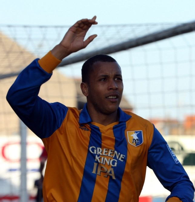 MANSFIELD, ENGLAND - APRIL 20:  Matt Green of Mansfield celebrates after he scores from the penalty spot during the Blue Square Bet Premier match between Mansfield Town and Wrexham at the One Call Stadium on April 20, 2013 in Mansfield, England.  (Photo by Ross Kinnaird/Getty Images)