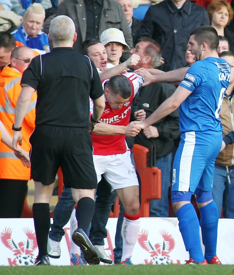 Football - Kidderminster Harriers v Stockport County - Blue Square Bet Premier - Aggborough Stadium - 20/4/13  Lee Vaughan of Kidderminster (C)  is attacked by a Stockport County fan  Mandatory Credit: Action Images  Livepic