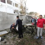 Libyan civilians and security forces gather near the destroyed wall of the French embassy in Tripoli following a car bomb, on April 23, 2013.  A car bomb blasted the embassy of France in Tripoli, injuring two French guards and causing serious damage to the building, embassy and Libyan sources said.  AFP PHOTO/MAHMUD TURKIAMAHMUD TURKIA/AFP/Getty Images