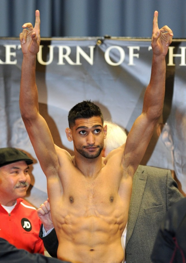 Amir Khan weighs in for his fight against Julio Diaz during the weigh in at the English Institute of Sport, Sheffield. PRESS ASSOCIATION Photo. Picture date: Friday April 26, 2013. See PA story BOXING Sheffield. Photo credit should read: Martin Rickett/PA Wire