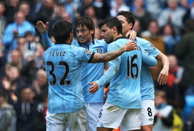 MANCHESTER, ENGLAND - APRIL 27: Sergio Aguero of Manchester City celebrates his opening goal with Carlos Tevez and David Silva during the Barclays Premier League match between Manchester City and West Ham United at the Etihad Stadium on April 27, 2013 in Manchester, England.  (Photo by Alex Livesey/Getty Images)