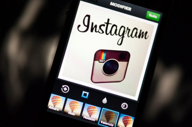 The Instagram logo is displayed on a smartphone on December 20, 2012 in Paris. Instagram backed down on December 18, 2012 from a planned policy change that appeared to clear the way for the mobile photo sharing service to sell pictures without compensation, after users cried foul. Changes to the Instagram privacy policy and terms of service set to take effect January 16 had included wording that appeared to allow people's pictures to be used by advertisers at Instagram or Facebook worldwide, royalty-free.   AFP PHOTO / LIONEL BONAVENTURE        (Photo credit should read LIONEL BONAVENTURE/AFP/Getty Images)