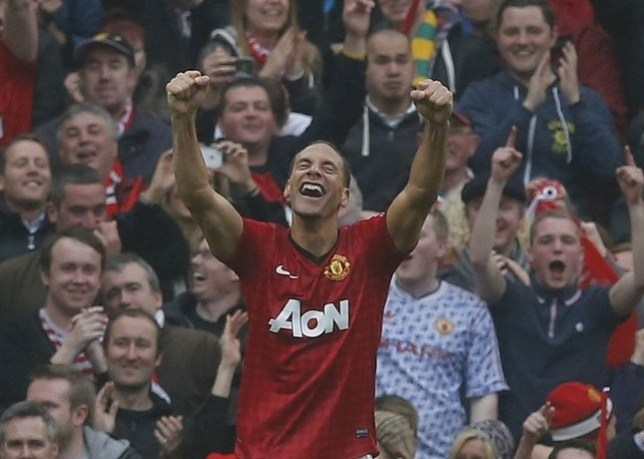 Concentrating on his club: Ferdinand celebrates his winner at Old Trafford on Sunday (Picture: Reuters)