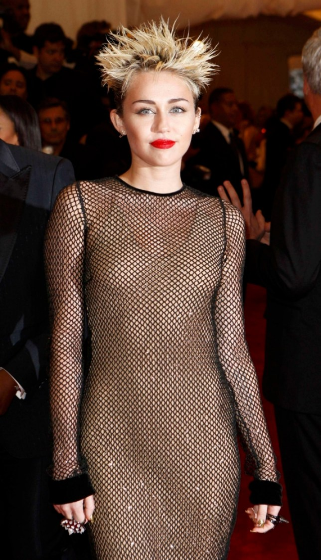 """Miley Cyrus arrives at the Metropolitan Museum of Art Costume Institute Benefit celebrating the opening of """"PUNK: Chaos to Couture"""" in New York"""