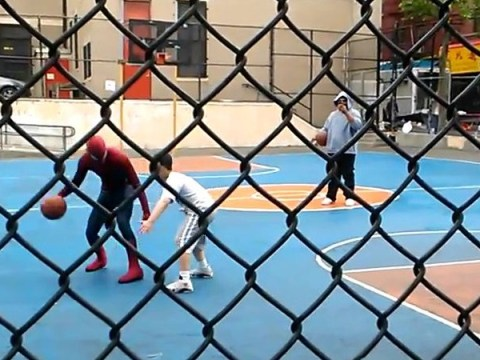 Andrew Garfield shoots hoops with kids dressed as Spider-Man