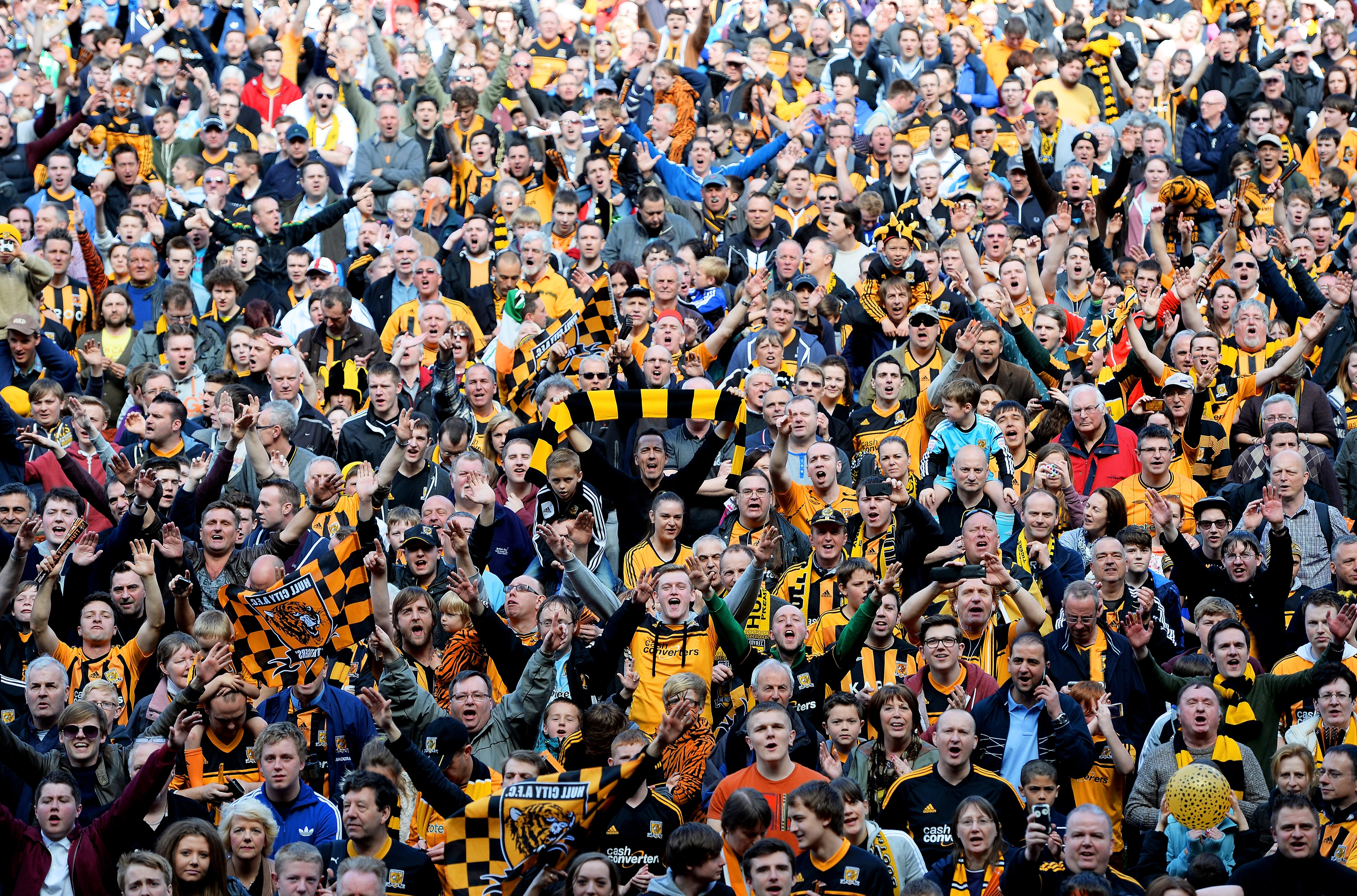 Hull fans run onto the pitch to celebrate their team's promotion to the Premier League (Picture: Getty)