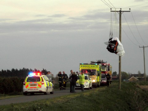 Lucky paramotor pilot cheats death after getting caught on power lines