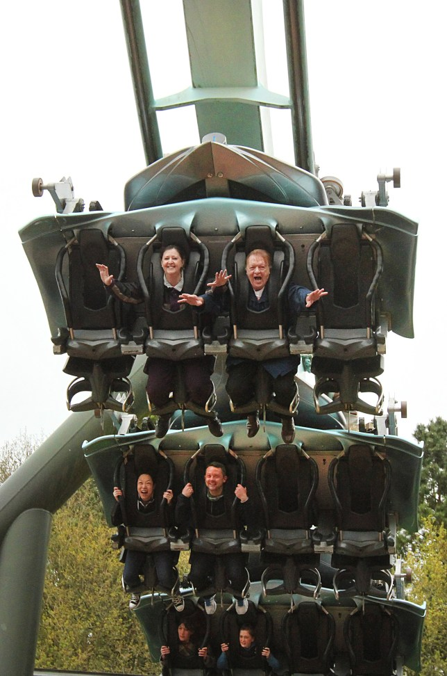 Hands up: Sylvia and Dennis Bloor at Alton Towers, where they started riding roller coasters in 1994 (Picture: Guzelian)