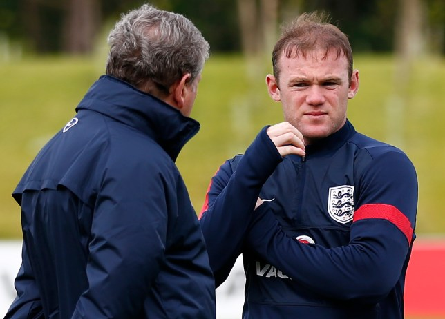 England's manager Hodgson speaks to Rooney during a soccer training session at the St George's Park training complex near Burton Upon Trent