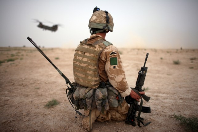 A British Army soldier from the 3rd Battalion The Parachute Regiment secures the helicopter landing strip (HLS) during operation Southern Beast on August 6, 2008 in Maywand District in Kandahar Province, Afghanistan. The British Army soldiers from the 3rd Battalion The Parachute Regiment spearheaded a strike operation in the Maywand District of the Kandahar Province, setting the conditions for a permanent ISAF presence to support the Afghan National Government in their fight against the Taliban. Striking within one of Afghanistan's major opium producing areas the Paratroopers were looking for weapons, drugs, and individuals related to the Taliban. During the operation about seventy kilograms of opium was seized and some weapons were recovered. (Photo by Marco Di Lauro/Getty Images)