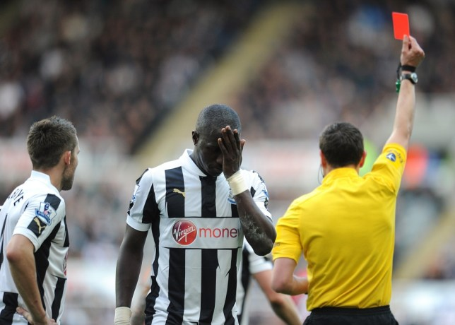 Newcastle United's Moussa Sissoko (centre) looks dejected as referee Andre Marriner shows Yohan Cabaye (left) the red card during the Barclays Premier League match at St James' Park, Newcastle. PRESS ASSOCIATION Photo. Picture date: Saturday April 27, 2013. See PA story SOCCER Newcastle. Photo credit should read: Owen Humphreys/PA Wire. RESTRICTIONS: Editorial use only. Maximum 45 images during a match. No video emulation or promotion as 'live'. No use in games, competitions, merchandise, betting or single club/player services. No use with unofficial audio, video, data, fixtures or club/league logos.