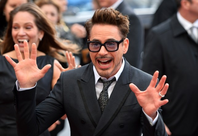 """US actor Robert Downey Jr. poses for picture on the red carpet as he arrives for the premier of his latest film """"Iron Man 3"""" in Leicester Square in central London in this April 18, 2013. """"Iron Man 3"""" is expected to launch America's summer blockbuster season with a bang this weekend, having already taken global box offices by storm, industry analysts say. Robert Downey Jr returns as the metal-suited Marvel superhero, in a sequel to the last """"Iron Man"""" movie in 2010, but also playing off the back of last year's comic-book mega hit """"The Avengers,"""" which also featured him. The film, starring Gwyneth Paltrow and Ben Kingsley as well, has already made nearly $200 million around the world in the last week, and could earn a similar sum in its first weekend in North America. AFP PHOTO/LEON NEALLEON NEAL/AFP/Getty Images"""