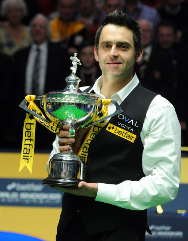 Ronnie O'Sullivan holds the trophy after winning the final match during the Betfair World Championships at the Crucible, Sheffield. PRESS ASSOCIATION Photo. Picture date: Monday May 6, 2013. See PA story SNOOKER World. Photo credit should read: Anna Gowthorpe/PA Wire