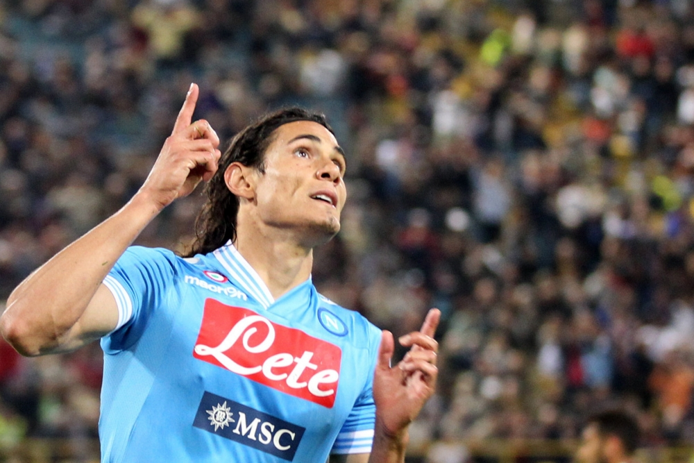 Napoli's Uruguayan forward Edinson Cavani celebrates after he scored a goal during their Serie A football match at the Renato dall'Ara stadium in Bologna on May 8, 2013. AFP PHOTO / MAURIZIO PARENTIMAURIZIO PARENTI/AFP/Getty Images