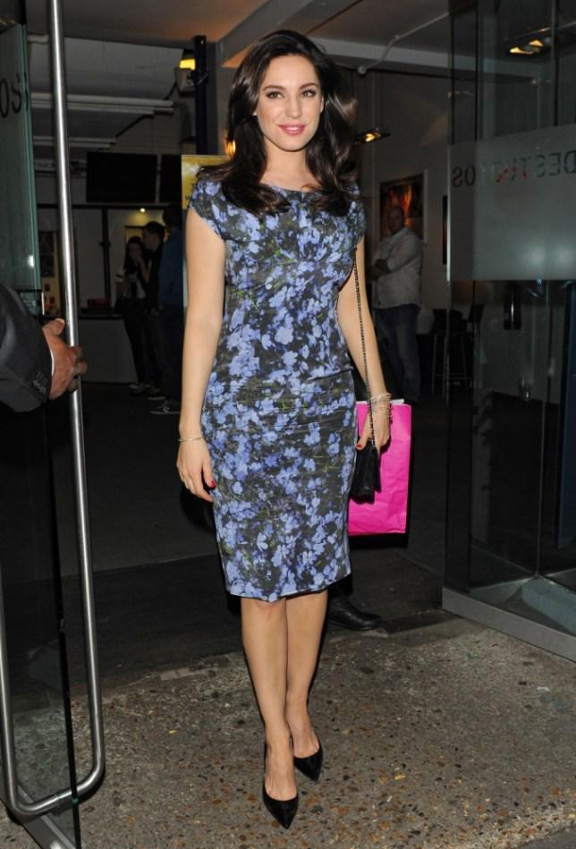 May 8, 2013: Kelly Brook, wearing a blue floral mini dress, leaves 'Celebrity Juice' at Riverside Studios in London, UK. Mandatory Credit: INFphoto.com Ref.: infuklo-190|sp|
