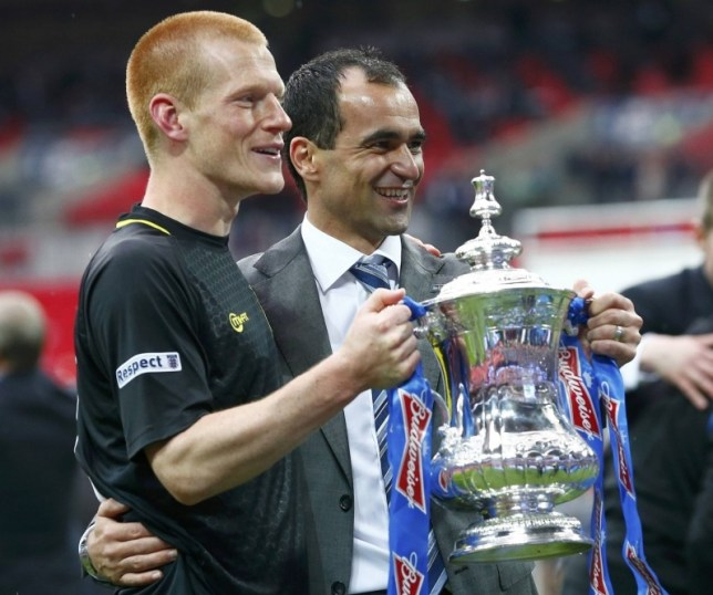 Wigan Athletic's manager Roberto Martinez (2nd L) holds the trophy with goalscorer Ben Watson after defeating Manchester City in their FA Cup final soccer match at Wembley Stadium in London May 11, 2013.     REUTERS/Darren Staples (BRITAIN  - Tags: SPORT SOCCER)
