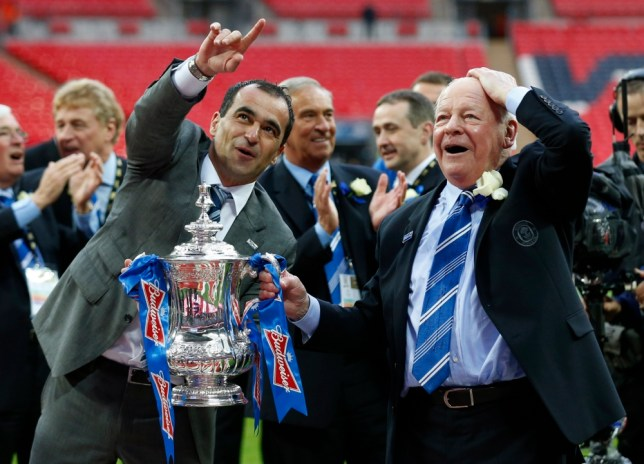 Wigan Athletic's chairman Dave Whelan, right, and manager Roberto Martinez celebrate with the trophy after their win against Manchester City at the end of their English FA Cup final soccer match at Wembley Stadium, London, Saturday, May 11, 2013. (AP Photo/Matt Dunham)