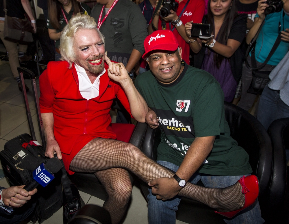 Sir Richard Branson dresses up as air stewardess after losing bet to AirAsia owner Tony Fernandes