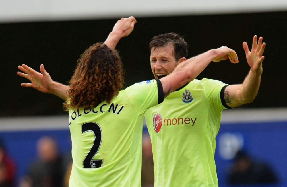 LONDON, ENGLAND - MAY 12:  Fabrizio Coloccini (2) and Mike Williamson (6) of Newcastle United celebrate as they avoid relegation after the Barclays Premier League match between Queens Park Rangers and Newcastle United at Loftus Road on May 12, 2013 in London, England.  (Photo by Shaun Botterill/Getty Images)