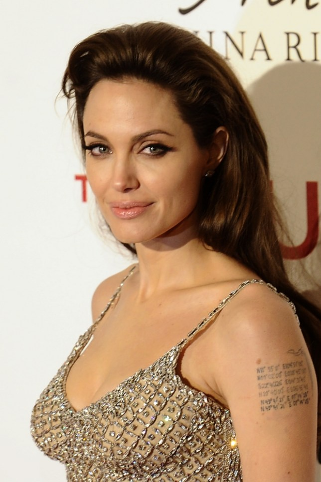 "(FILES) December 16, 2010 file photo shows US actress Angelina Jolie posing as she arrives for the premiere of her last film ""the Tourist"" at the Palacio de Deportes of Madrid.  Angelina Jolie revealed mAY 14, 2013 that she has undergone a preventive double mastectomy to reduce her risk of cancer.  The American actress wrote in an opinion piece entitled ""My Medical Choice"" in The New York Times that she had chosen the procedure because she carries a faulty gene that increases her risk of breast and ovarian cancer.      AFP PHOTO/ PIERRE-PHILIPPE MARCOU / FILESPIERRE-PHILIPPE MARCOU/AFP/Getty Images"